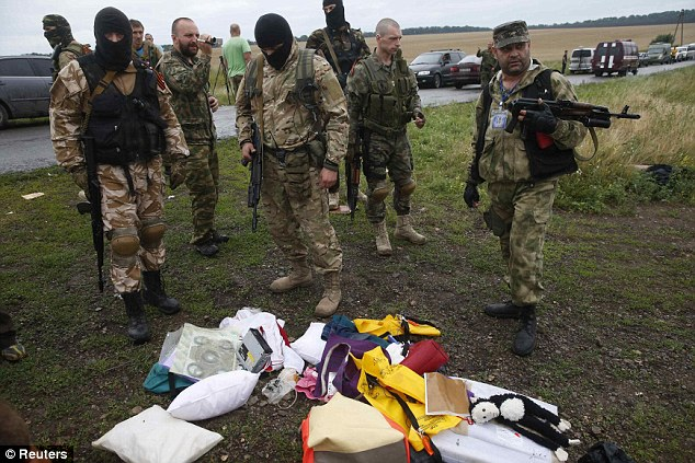 Tony Abbott has sought advice from his security, police and defence chiefs for options to help secure the crash site to avoid pro-Russian militants (pictured) and others from gaining access