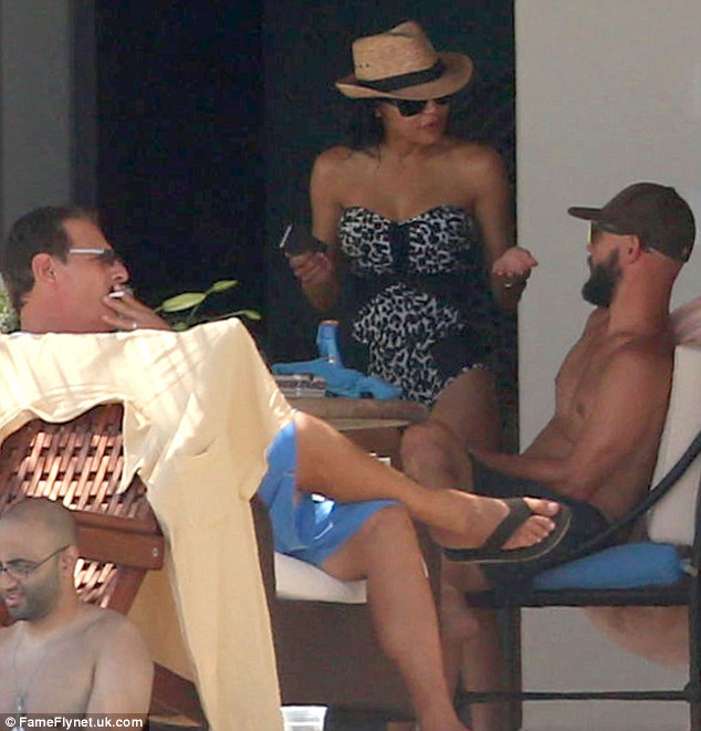 Having a chat: Naya talked with some friends as she got out of the sun for a bit
