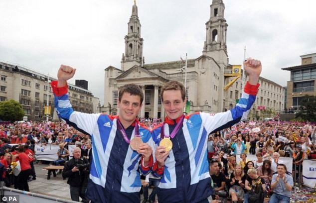 Olympic medalists Jonny, left, and Alistair Brownlee who spotted the Sri Lankans cycling down the motorway