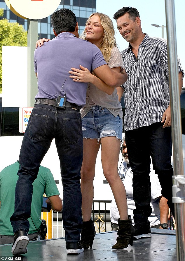 The host with the most: LeAnn and Eddie greeted Extra's Mario Lopez when they arrived at the Los Angeles set which is based at Universal Studios