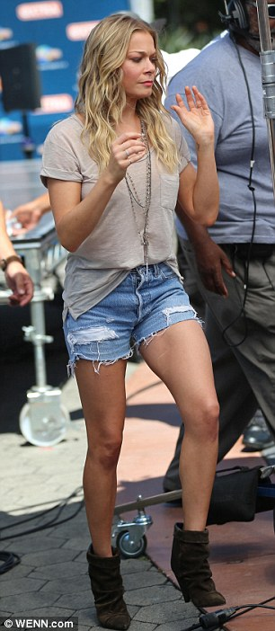 Putting her assets forward: LeAnn once again showed off her toned legs in tiny denim cutoff shorts