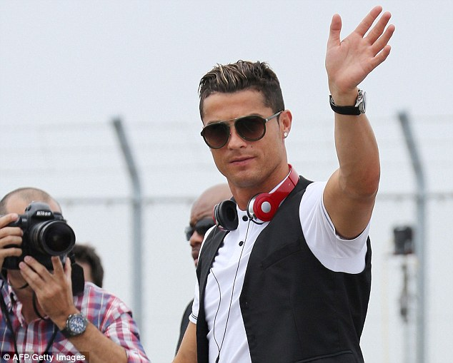 Star appeal: Cristiano Ronaldo waves to fans during his visit to Japan earlier this week