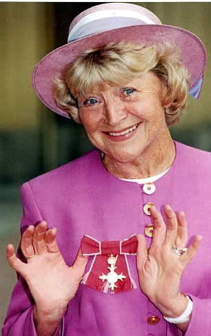 Dora at Buckingham Palace with her 1996 OBE