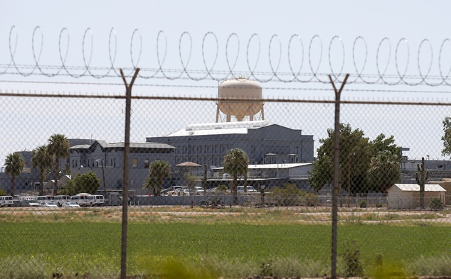 Going forward: A fence surrounds the state prison in Florence, Arizona where the execution of Joseph Rudolph Wood was scheduled to take place on Wednesday