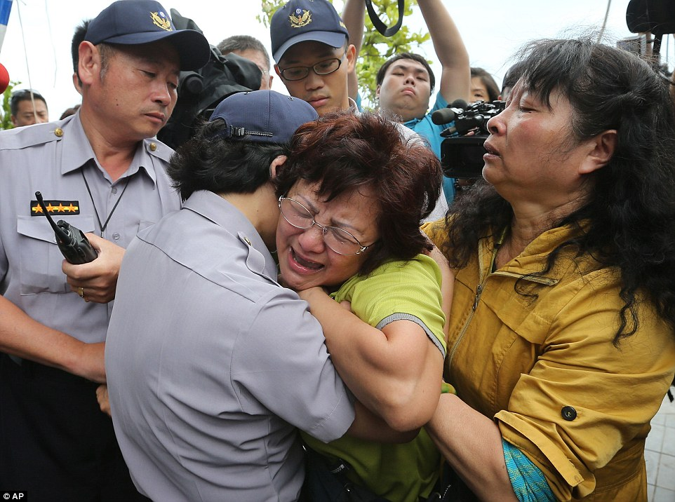 A relative of a passenger onboard the TransAsia Airways Flight GE222 that crashed on the Taiwanese island of Penghu, cries at a funeral parlor in Penghu