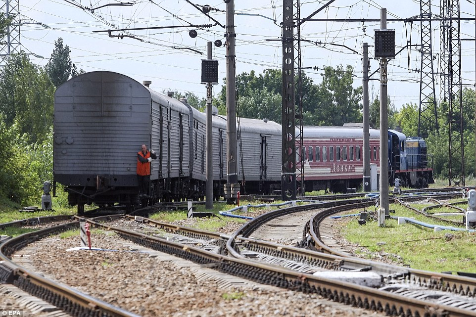 Journey: The bodies of 200 victims were transported from near the MH17 crash site to Kharkiv airport by refrigerated train (pictured) earlier this week