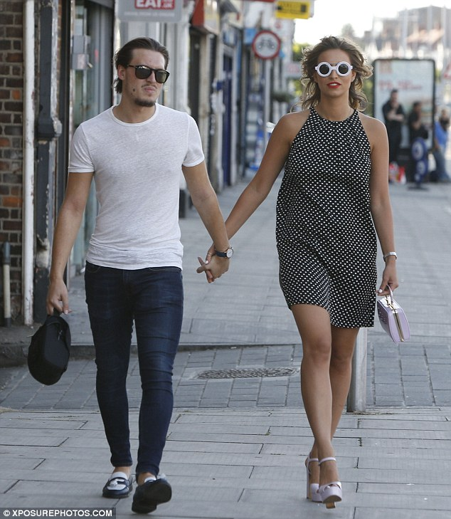 Step back in time: Ferne and Charlie  had held hands as they walked into the Tinsel Town American Diner in Essex