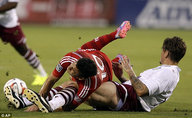 Sliding in: Chris Herd is penalised for a rough tackle on Mauro Diazas early on