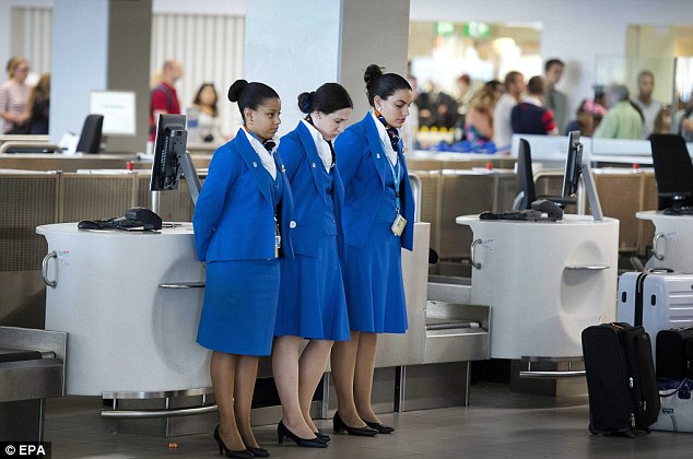 Remembrance: Stewardesses at Schiphol airport observe one-minute of silence in remembrance of the victims of flight MH17