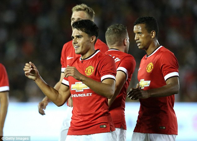 Staking a claim: Reece James (centre) starred in the second half of United's 7-0 win over LA Galaxy