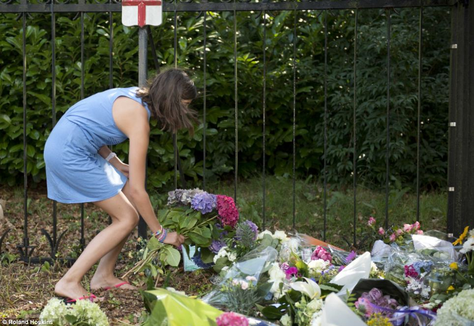 Paying tribute: A girl leaves flowers outside Hilversum's Korporaal Van Oudheusden Kazerne military base, where the victims' bodies are being returned for identification