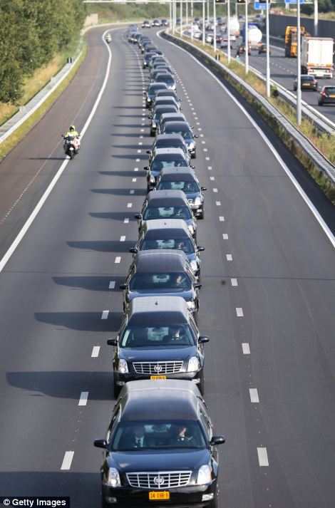A convoy of hearses carry bodies and remains from those killed on Malaysian Airlines flight MH17 on July 24, 2014 in Boxtel, Netherlands