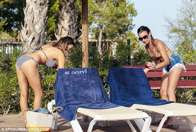The perfect spot: The pair were seen arranging their towels as they took time out from wedding prep