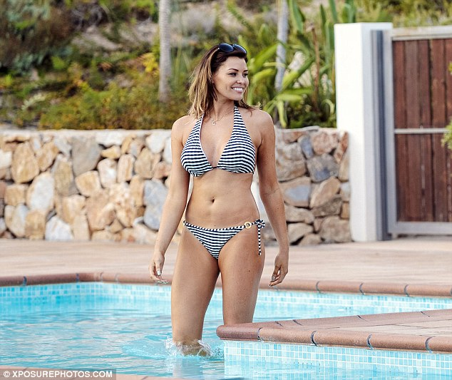 Turning heads: Jessica Wright showed off her toned figure as she relaxed poolside in Alicante on Friday