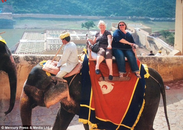 Anna Grainger showed this photo of her riding an elephant in Thailand to her work colleagues, prompting the cruel comment: 'Which one is the elephant?'