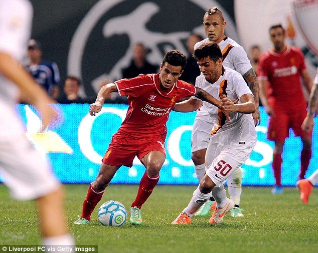 Star man: Philippe Coutinho (left) has been hailed as the 'brain of Liverpool's team' by boss Brendan Rodgers