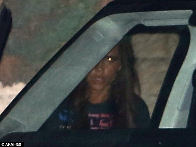 Quick exit: Victoria Beckham snuck out of the restaurant's private exit on Wednesday night, making a mad dash for her awaiting ride.