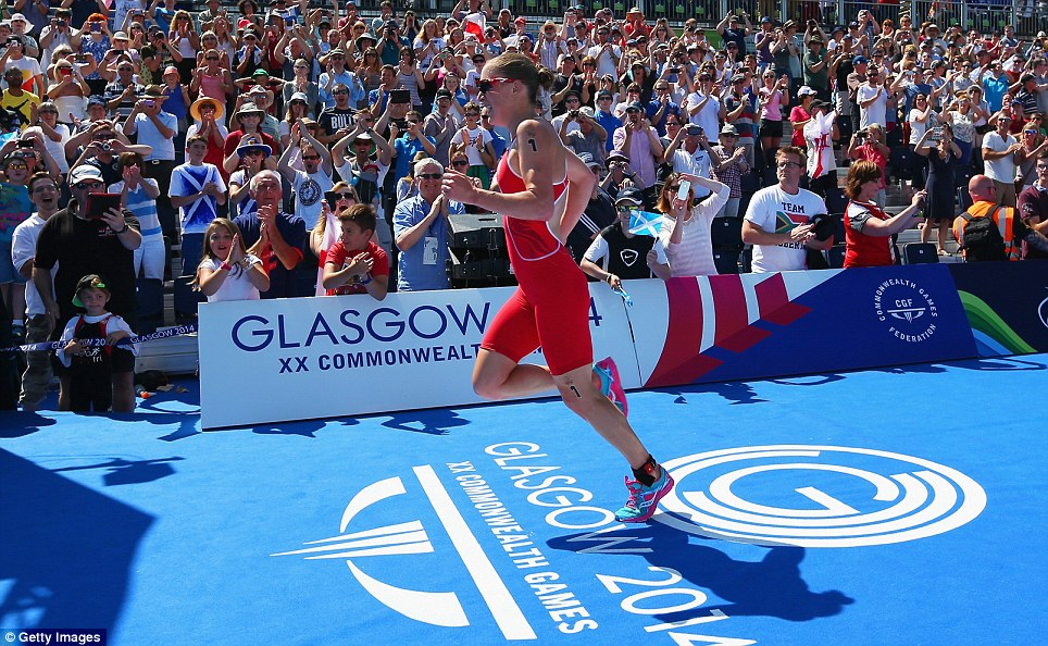Great support: Fans in Scotland cheer on Stimpson down the back straight as she storms to victory