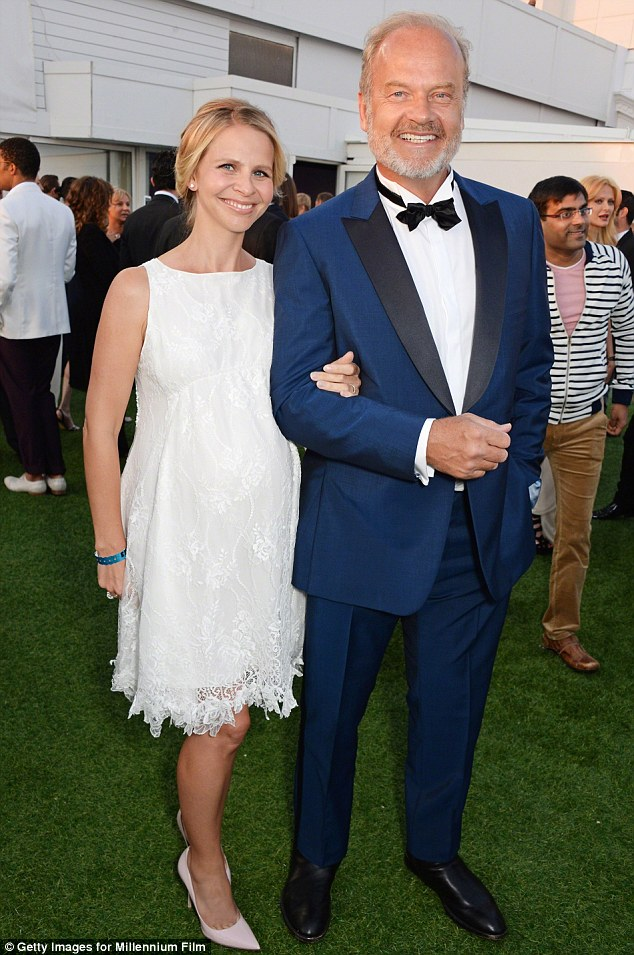 Handsome couple: Kelsey and pregnant Kayte pictured in Cannes in May