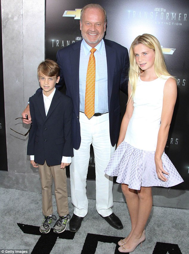 Doting dad: Kelsey with daughter Mason Olivia, 13, and son Jude Gordon, nine, at the Transformers premiere in NYC in June