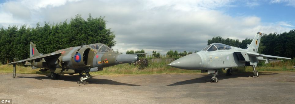A 1976 Hawker Siddeley Harrier GR3 Jump Jet, left, and a 1988 Panavia Tornado F3, right, which are set to be auctioned off at Silverstone racetrack this weekend