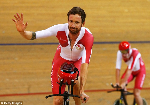 Still smiling: Wiggins waves to the crowd inside the Sir Chris Hoy Velodrome after defeat to Australia