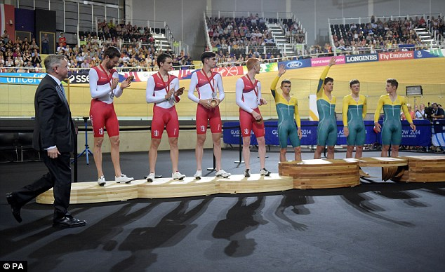 Respect: England's cyclists applaud their Australian rivals as they step up to receive their gold medals