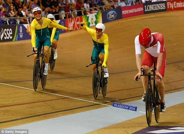 All smiles: Aussie duo Alex Edmondson and Luke Davison raise their arms in celebration at the end of the race