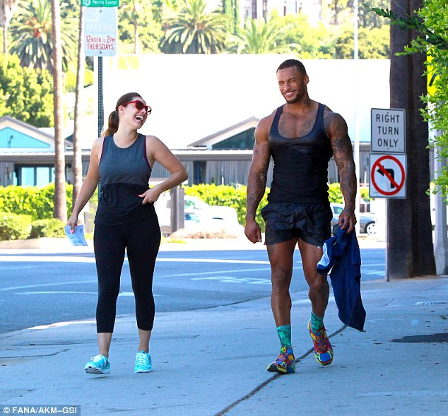 Major lols: Kelly Brook could barely contain her laughter as she left the gym with her pleather-clad fiancé David McIntosh in Studio City, California on Thursday