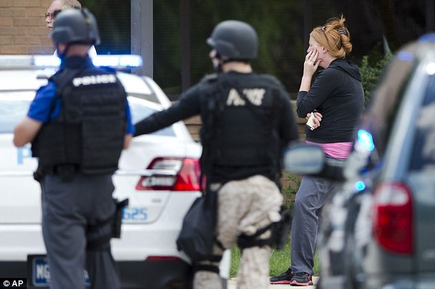 Terrifying: Around 100 terrified people ran out of the hospital's wellness center as SWAT teams rushed in