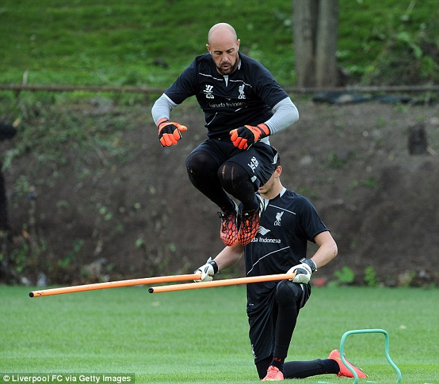 Jumping high: Goalkeeper Reina jumps over poles during training for Liverpool at Harvard University