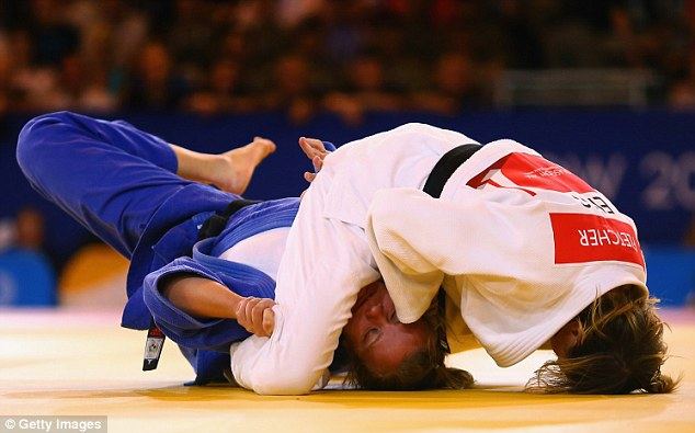 Winner: England's Megan Fletcher pins down Moira de Villiers of New Zealand in the under-70kg judo final