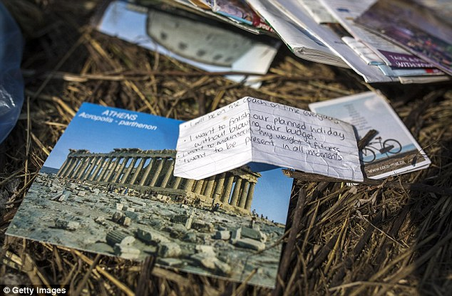 Heartbreaking: A handwritten note amongst the wreckage reads 'I want to finish our planned holiday without blowing our budget'