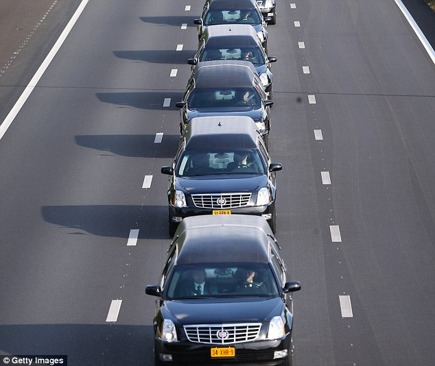 A convoy of hearses carry bodies and remains from those killed on Malaysian Airlines flight MH17 on July 24, in Boxtel, Netherlands