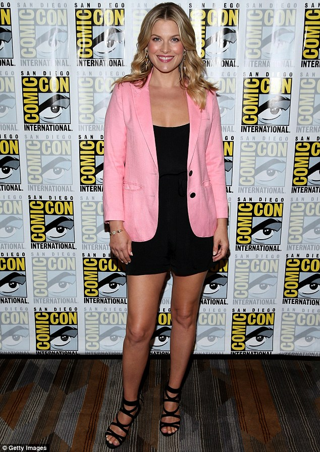 Pretty in pastel: Ali Larter brightened up her basic black jumpsuit with a stylish pink blazer while promoting her new series Legends at Comic Con in San Diego, California on Thursday