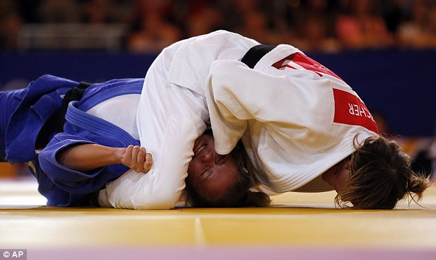 Pressure: Fletcher got emotional after her gold win and dedicated it to her former coach Don Werner