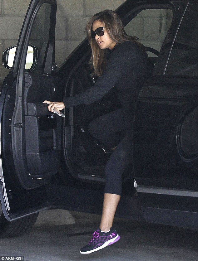 Riding high: Vanessa cut an incredible figure in her stylish ensemble as she darted out of the car