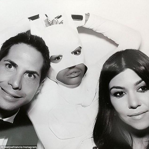 Clowning around: Jaden posed during a photo booth session at Kim's wedding, alongside Kourtney Kardashian and Girls Gone Wild founder Joe Francis