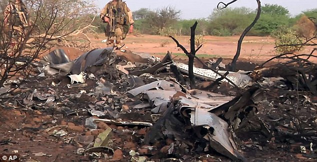 Mangled: The plane. travelling from Burkina Faso to Algeria, came down near the border with Mali