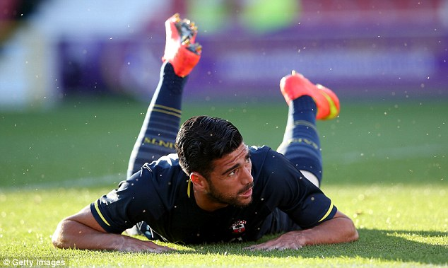 Floored: New Southampton striker Graziano Pelle looks on during the Saints' friendly win over Swindon