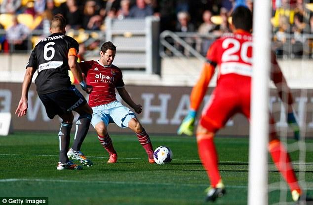 Deflection: Matt Jarvis' cross deflected off Sydney captain Nikola Petkovic and into the back of the net