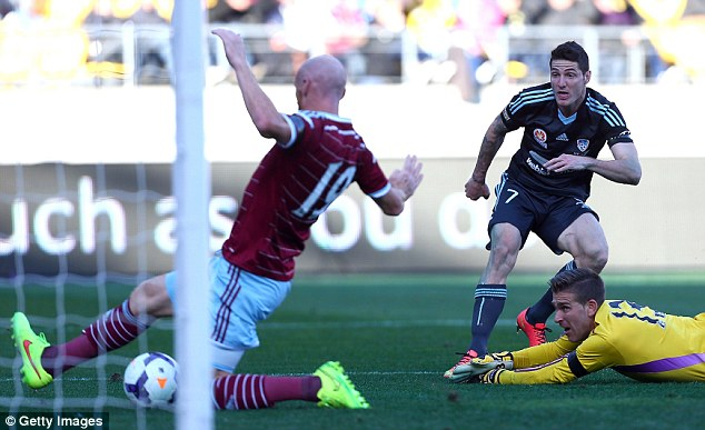 Game over: West Ham defender James Collins is unable to stop Gameiro scoring his second goal of the match