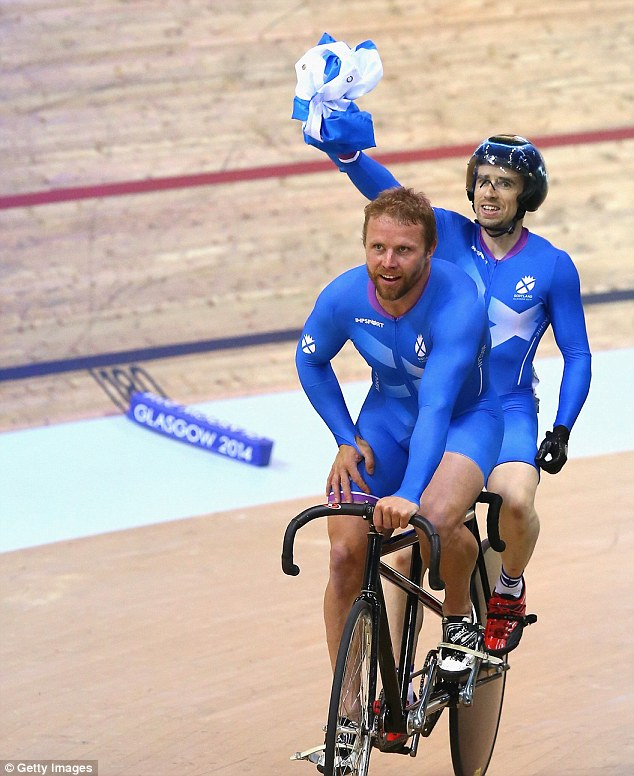 Pride: Neil Fachie and pilot Craig MacLean celebrate after winning the tandem final on Saturday