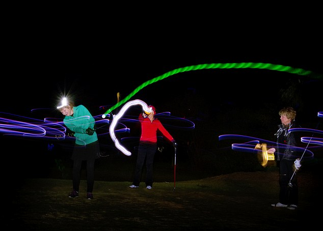 The Castle Hill Country golf club is lit up with colourful neon lights