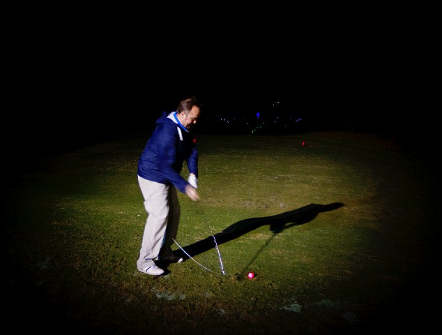 Light It Up Golf owners, Brad and Joel McIntosh, set up thousands of custom lights around nine hole golf courses and light up pins and holes to help golfers navigate their way in the dark