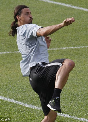 High flyer: Zlatan Ibrahimovic goes up for a header