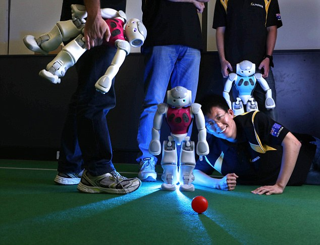 The UNSW team wrote an impressive 125,000 lines of code to help their 15 robot protégés to victory