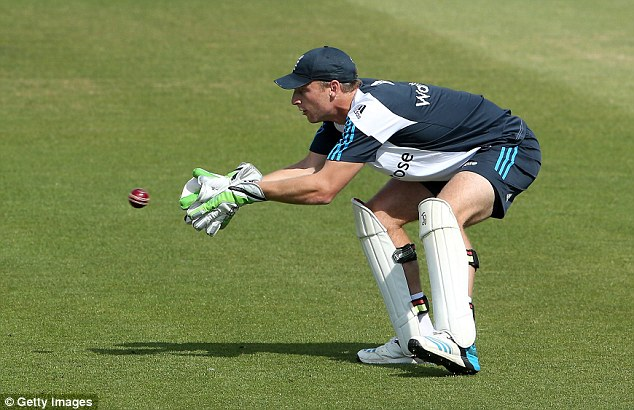 Glove work: Jos Buttler prepares for his Test debut as he comes in for Matt Prior