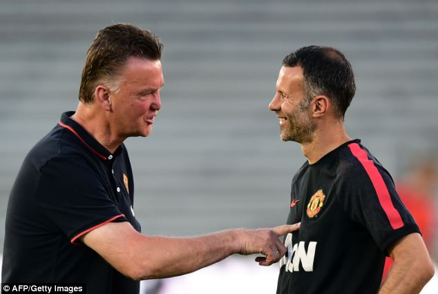 All smiles: Van Gaal and Giggs will be eager to get United back on the trophy haul as soon as possible