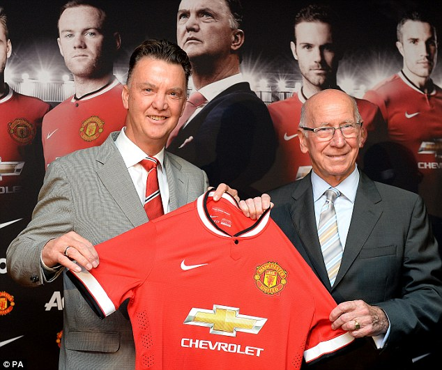 Proud: Van Gaal, alongside club legend and ambassador Sir Bobby Charlton, is delighted to be United's manager